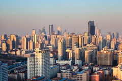 Modern city at dusk in shanghai Stock Images