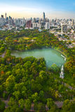 Modern city in a green environment. Suan Lum Lumpini Park is green space in Bangkok, Thailand Stock Photo