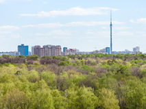 Modern city and green woods in spring Stock Photos