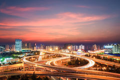 Modern city interchange in nightfall Stock Images
