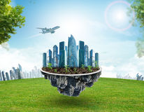 Modern city on island with green grass Stock Photos