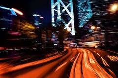Modern city motion blur. Hong Kong. Abstract cityscape traffic b Stock Photos