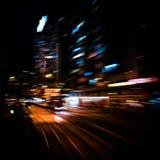 Modern city motion blur. Hong Kong. Abstract cityscape traffic Royalty Free Stock Image