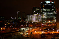 Modern city at night. With buildings being built stock photography