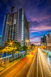 Modern city at night with cars light lines. Stock Photo