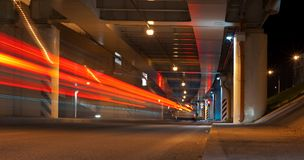 Long exposure shot of a street at night. Modern city at night. Long exposure shot of a street at night creating dynamic effect of the vehicle lights Stock Image