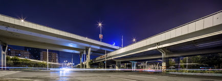 Modern city night under the road and. Road and overpass under the modern city of China Royalty Free Stock Photos