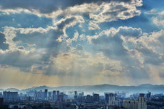 Modern city silhouette. Modern city under sun ray Royalty Free Stock Images