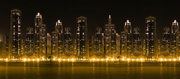 Modern city skyline at hight with illuminated skyscrapers Stock Image