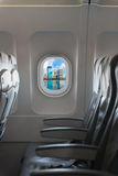 Modern city skyline through window on a commercial airliner airc Stock Photos