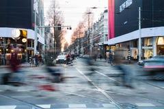 Modern city street downtown blur traffic bikes, Amsterdam Royalty Free Stock Photos