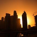 Modern city. Sunset over modern city, silhouette Stock Image