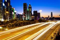 Modern City Traffic At Night In Hong Kong Stock Photos