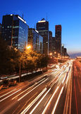 Modern city with traffic at dusk royalty free stock image