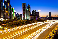 Modern city traffic at night in Hong Kong Stock Photos
