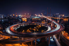 Modern city traffic road at night. Transport junction. Stock Image