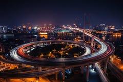 Modern city traffic road at night. Transport junction. Modern city traffic road. Transport road junction on the bridge Stock Image