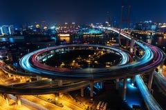 Modern city traffic road at night. Transport junction. Modern city traffic road. Transport road junction on the bridge Stock Photos