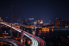 Modern city traffic road at night. Transport junction. Stock Photos