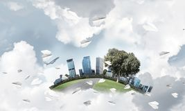 Concept of eco green life as elegant business center on white cl. Modern cityscape with buildings and skyscrapers floating on clouds in sky Royalty Free Illustration