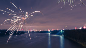 Modern cityscape with fireworks on New Years Eve royalty free stock photo