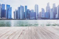Modern cityscape skyline. And empty wooden floor Royalty Free Stock Image