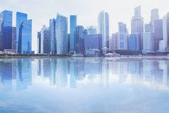 Modern cityscape skyline with reflection in the water. Business office buildings background with copyspace Royalty Free Stock Images