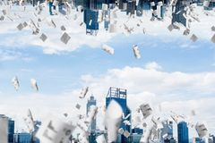 Modern cityscape view. Abstract image of two modern urban worlds located among flying papers and upside down to each other on the sky background. Wallpaper Royalty Free Stock Images