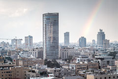 Modern cityscape view with rainbow Royalty Free Stock Images