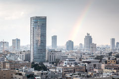 Modern cityscape view with rainbow Royalty Free Stock Image