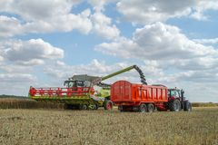 Modern claas combine harvester cutting crops Royalty Free Stock Photography