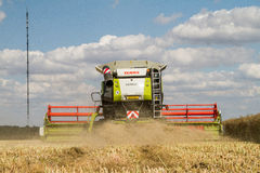 Modern claas combine harvester cutting crops Royalty Free Stock Images