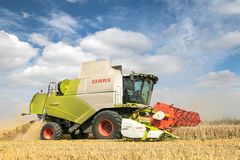 Modern claas combine harvester with header up cutting crops Stock Photos
