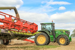 Modern claas combine harvester with header up cutting crops Royalty Free Stock Photos