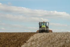 Modern claas tractor cultivating field Royalty Free Stock Images
