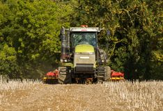 Modern claas tractor cultivating field Royalty Free Stock Image