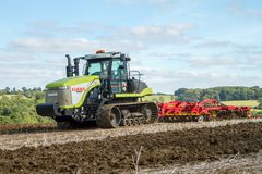 Modern claas tractor cultivating field Stock Images