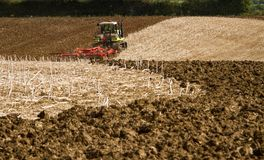 Modern claas tractor cultivating field Royalty Free Stock Photography