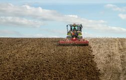 Modern claas tractor cultivating field Royalty Free Stock Photo