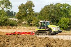 Modern claas tractor cultivating field Royalty Free Stock Photos