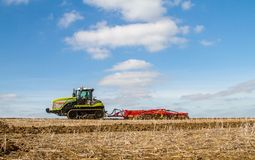 Modern claas tractor cultivating field Stock Photography