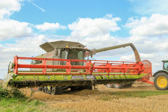Modern class combine harvester with header in the air Stock Image