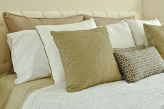 Modern classic bedding with brown, beige and light brown p Stock Photo