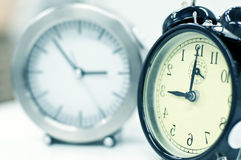 Modern and classic clock. A classic alarm clock and a modern one Stock Photography