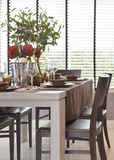 Modern classic dining set on table with natural lighting Stock Images