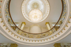 Modern classic  interior view with Chandelier hanging from a ceil Royalty Free Stock Images