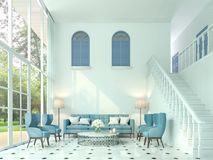 Modern classic living room 3d render,There are white room and stairs up to the upper floor. Furnished with blue furniture Royalty Free Stock Photo