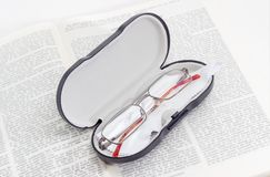 Modern classic mens eyeglasses in case on the open book. Modern classic men`s eyeglasses in case on the open book Stock Photos