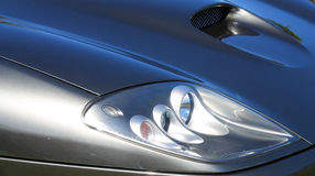 Modern classic sports car headlamps stock photo