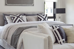 Modern classic style bedding with comfortable sofa in the bedroom stock images